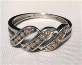 Lady's Silver-Diamond Ring 11 Diamonds .11 Carat T.W. 925 Silver 2.06g
